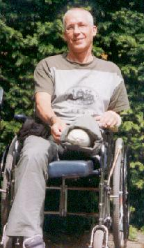 Co LeDahu proudly showing his stump in the wheelchair