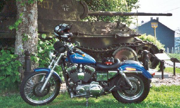 Sportster in front of a Panther in the Ardennes